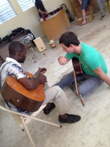 Bradley Rhodes teaching music in Haiti.